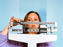 Obese Woman Checking her Weight