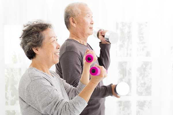 Happy-Senior-Couple-Exercising