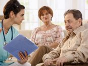 Nurse talking with elderly paitents